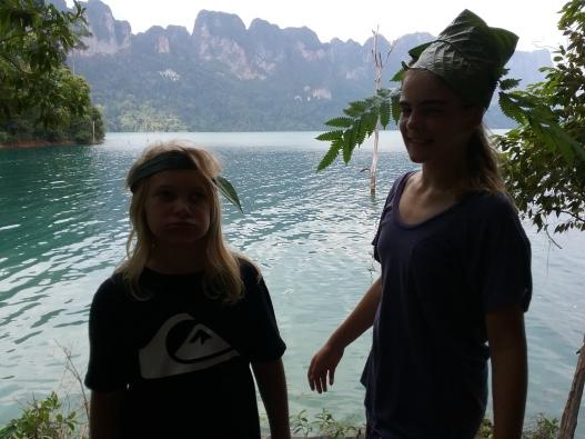 thailand - kids wearing jungle plant hats